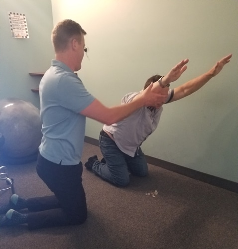 Patient Doing Rehab Exercises at Peak Performance Chiropractic
